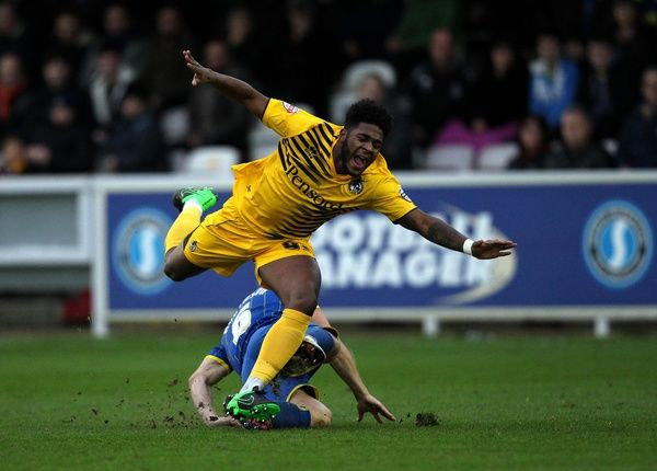 Ellis Harrison of Bristol Rovers is fouled by Paul Robinson of AFC Wimbledon - Mandatory byline: Robbie Stephenson/JMP - - 26/12/2015 - FOOTBALL - Kingsmeadow Stadium - Wimbledon, England - AFC Wimbledon v Bristol Rovers - Sky Bet League Two
