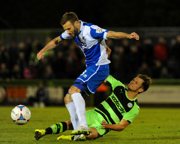 Forest Green Rovers's James Norwood tackles Bristol Rovers' Andy Monkhouse- Photo mandatory by-line: Nizaam Jones/JMP - Mobile: - 29/04/2015 - SPORT - Football - Nailsworth - The New Lawn - Forest Green Rovers v Bristol Rovers - Vanarama Football