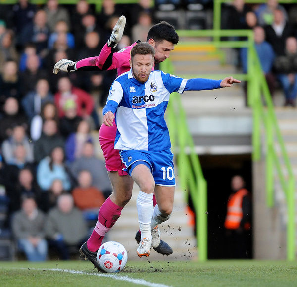 Bristol Rovers' Matty Taylor gets past Forest Green Rovers's Steve Arnold - Photo mandatory by-line: Neil Brookman/JMP - Mobile: - 29/04/2015 - SPORT - Football - Nailsworth - The New Lawn - Forest Green Rovers v Bristol Rovers - Vanarama Football
