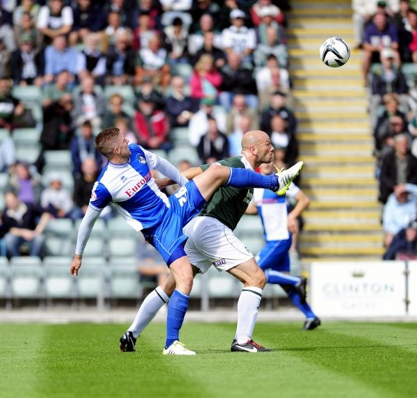 Bristol Rovers' Ryan Brunt jostles for the ball with Plymouth Argyle's Guy Branston - Photo mandatory by-line: Dougie Allward/JMP - Tel: Mobile: 07/09/2013 - SPORT - FOOTBALL - Home Park - Plymouth - Plymouth Argyle V Bristol Rovers - Sky Bet